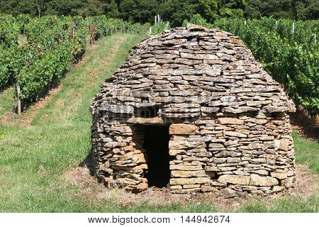 Old and typical stone hut in the vineyards of Beaujolais, France