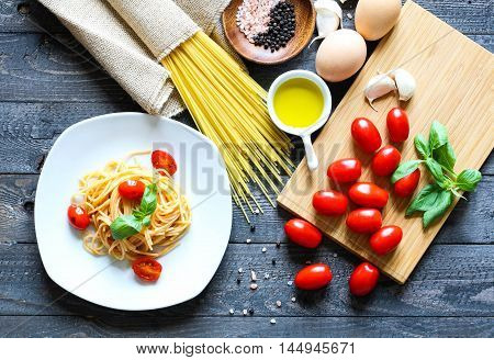 Top View Of Italian Ingredients For Tomato And Basilic Spaghetti.