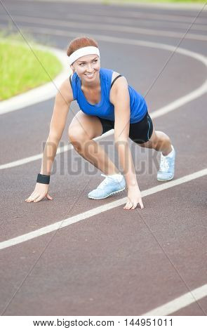 Young Happy Smiling Caucasian Female Athlete Training on Sport Venue Outdoors.Vertical Image