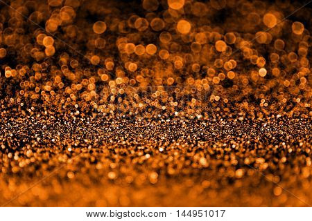 Abstract spooky dark orange and black glitter sparkle fright night background for Halloween trick or treat party invite or flyer