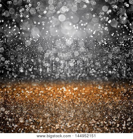 Abstract dark black and orange glitter sparkle background texture for happy Halloween party invitation or trick or treat fright night