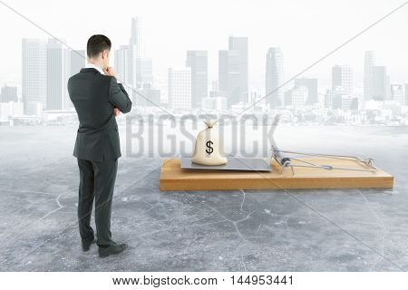 Business man looking at abstract mousetrap with money sack on city background. Risk concept. 3D Rendering