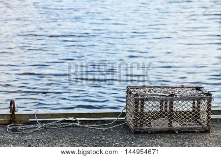 Fish trap cages for trapping aquqtic animals crabs in port on sea shore.
