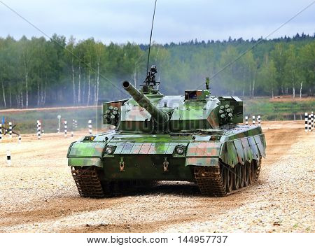 MOSCOW REGION - AUGUST 16: Chinese main battle tank on a march over rough terrain  -  on August 16, 2014 in Moscow region