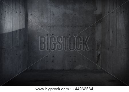 Dark concrete room or wall and floor. with incoming light reflection on left wall.