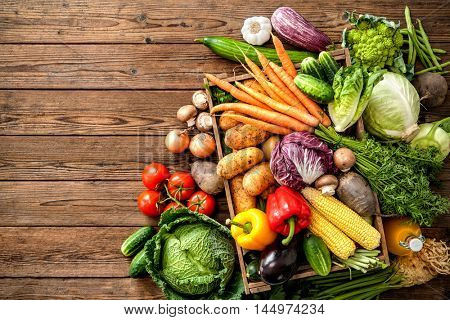 Assortment of  fresh vegetables  on wooden background