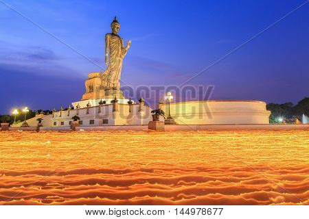 Makha Bucha Day Candle lit from buddhists are moving around Buddha statue at the Phutthamonthon district Nakhon Pathom Province of Thailand