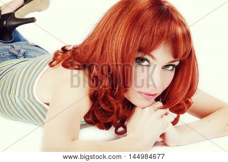 Vintage style portrait of young beautiful sexy red-haired thoughtful girl with bob haircut and stylish make-up