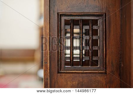 Wooden Window Of Confessional Box At Church