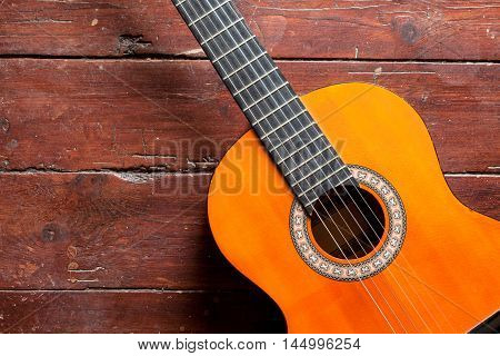 wood guitar background music musical wooden instrument equipment old acoustic rock play style vintage dirty empty art texture floor retro performance concept leisure old-fashioned natural dramatic indoor interior revival concert decoration;classic folk cl