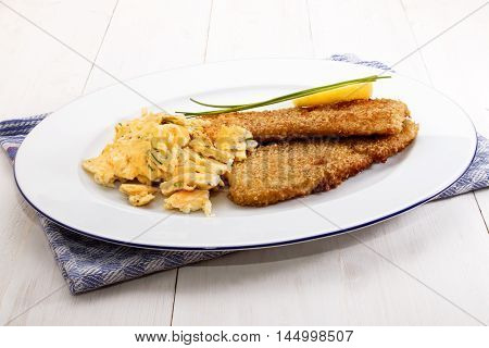 old full scottish breakfast with kipper fried with oat bran and scrambled eggs