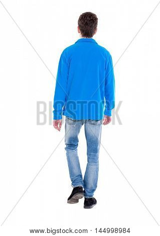 Back view of going handsome man. Curly boy in blue sweater goes out of frame.