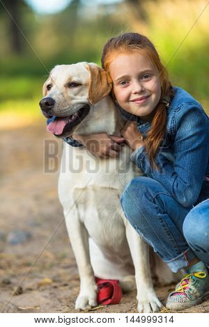 Ten-year-old girl with a dog.