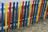 Closeup of a colorful garden fence of wood - old fence revitalized by vivid colors poster
