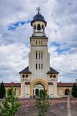 Bell tower of Coronation Cathedral deticated to Holy Trinity in Citadel of Alba Iulia city in Romania poster