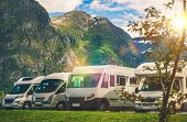 Scenic RV Park Camping. Few Camper Vans in Remote Location. RVing Theme. poster