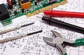 Printed circuit board with electrical components precision tools and cable of multimeter on construction drawing of electronics engineer jobs poster