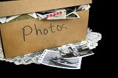 Old family photos in generic brown cardboard box on lace doily. poster