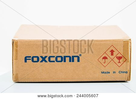 London, United Kingdom - Aug 23, 2018: Unboxing Front View Of Foxconn Cardboard Delivery Box With Lo