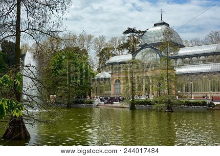 Madrid, Spain - April 23, 2018: Beautiful View Of The Majestic Glass Palace In The Park Of Good Reti