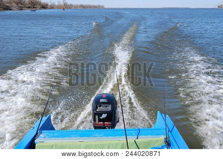Astrakhan Region, Russia - April 6, 2009: Motor Boat Rushes On The Volga River. Spinning Fishing. Sp