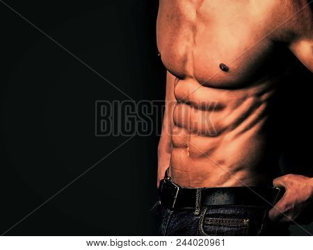 Sexy Gay. Man With Muscular Body And Torso. Athletic Bodybuilder Man On Black Background. Dieting An