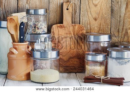Arrangement Of Dry Food Products And Kitchen Utensils In The Kitchen. Home Kitchen Rustic Still Life