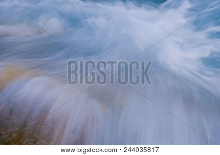 In The Flow: White Rapid Water Rushing Over Rocks As It Comes Towards The Camera, France