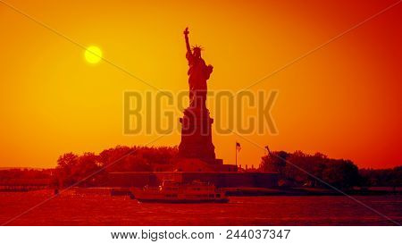 An image of the Liberty Statue at sunset