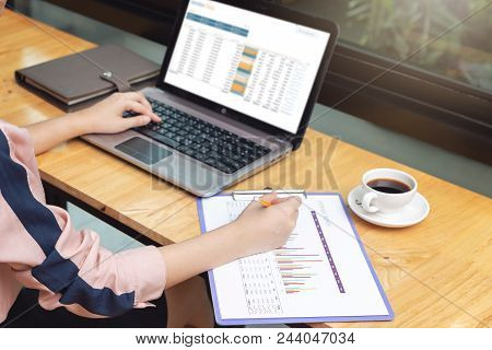 Business And Finance Concept, Businesswoman Discussing Sale Analysis Chart In Coffee Shop