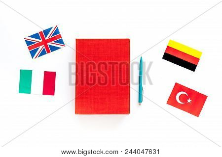 Language Study Concept. Textbooks Or Dictionaries Of Foreign Language On White Backgrond Top View.