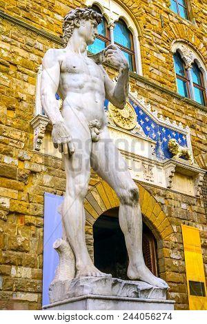 Michelangelo David Replica Statue Piazza Signoria Palazzo Vecchio Florence Tuscany Italy.  Replica of Michelangelo's David statue in front of Palazzo Vecchio, Florence Town Hall poster