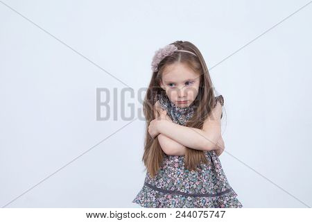 Little Girl With Upset Emotion. Unhappy Child. Toddler In Bad Mood. Emotional Girl. Angry Emotions.