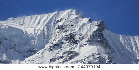 Mountain Ridge Of The Langtang Himal Range Covered By Snow And Glacier.