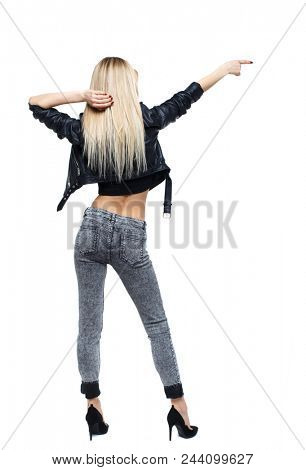 Back view of a woman i pointing. Rear view people collection.  backside view of person.  Isolated over white background. Blonde on heels showing a hand in the side