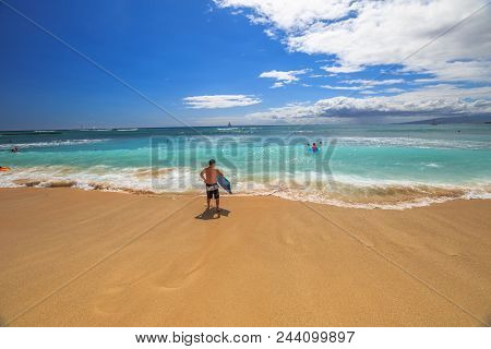 Waikiki, Oahu, Hawaii, United States - August 27, 2016: Man Holding A Surfboard For Boogie Boards In