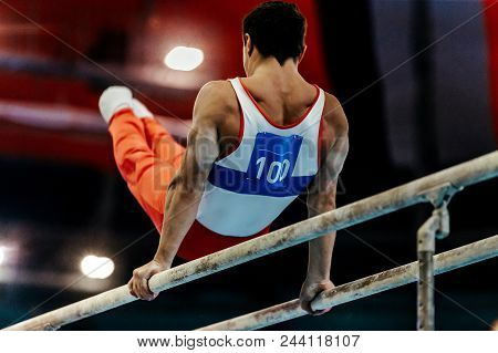 Sports Gymnastics Athlete Gymnast Exercises On Parallel Bars