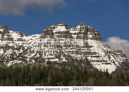 Wyoming Mountain With Light Snow Showing Rock Layers
