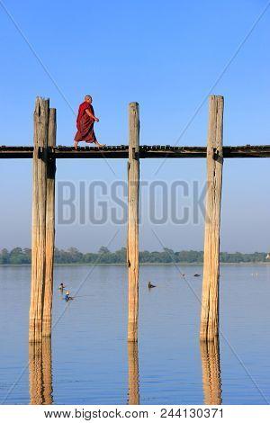 Amarapura, Myanmar - December 31: An Unidentified Monk Walks On U Bein Bridge On December 31, 2011 I