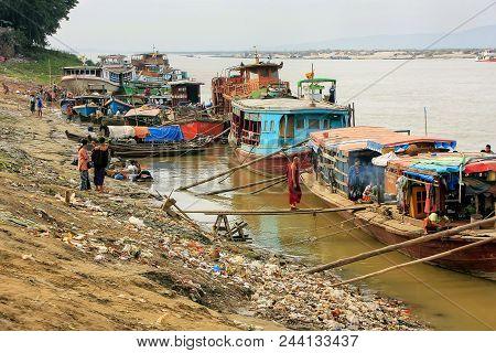 Mandalay, Myanmar - December 30: Boats Anchored At Ayeyarwady River Port On December 30, 2011 In Man