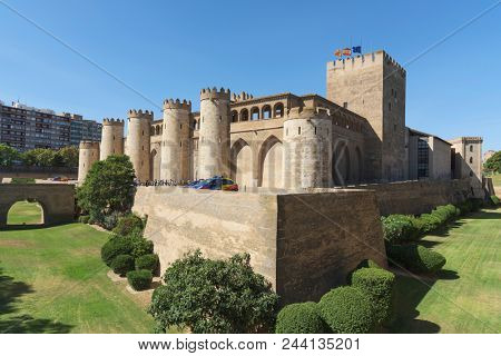 ZARAGOZA, SPAIN - AUGUST 20, 2017: A line of tourist at the entrance of the Aljaferia Palace in Zaragoza, Spain, a fortified medieval Islamic palace built during the eleven century