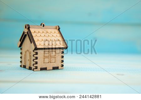 Small Model Of House On The Blue Background. Real Estate Concept. New House Concept. Mortgage Concep