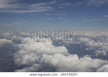 Textured Clouds Above The Clouds At High Altitude In Flight, Blue Sky.