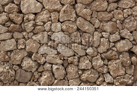 The Texture Of The Stone Slab In Cracks And Stains. Stone Wall.