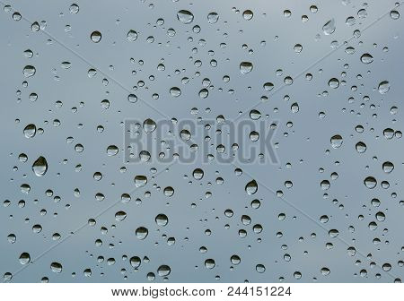 Textured Water Drops On The Window Glass. After The Rain.