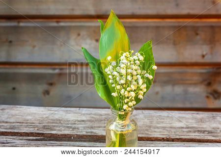 Bouquet Of Flowers Beautiful Smell Lily Of The Valley Or May-lily In Glass Vase On Rustic Old Vintag