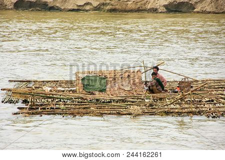 Mandalay, Myanmar - December 30: Unidentified Men Float On A Bamboo Raft Down Ayeyarwady River On De
