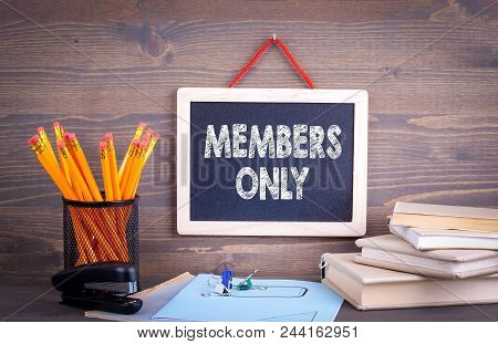 Members Only, Business Concept. Chalkboard On A Wooden Background.