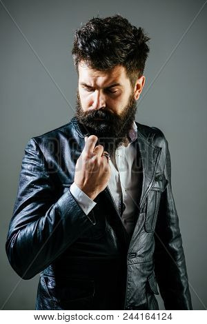 Bearded Man In Black Jacket. Pensive Man In In Leather Jacket. Barber Shop Concept. Fashion. Trendy
