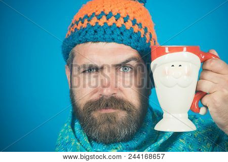 Handsome Serious Man Holding Cup With Hot Drink In Hand - Drinks And Leisure Concept. Hot Drinks For